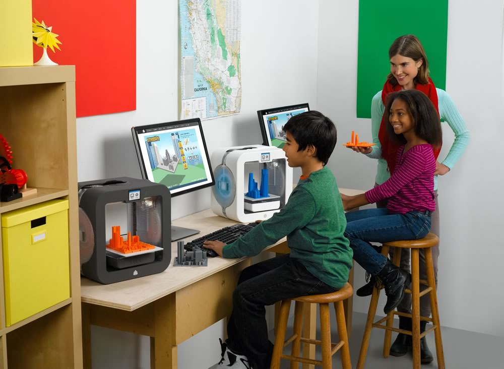 young boy and girl on 3d printing computer