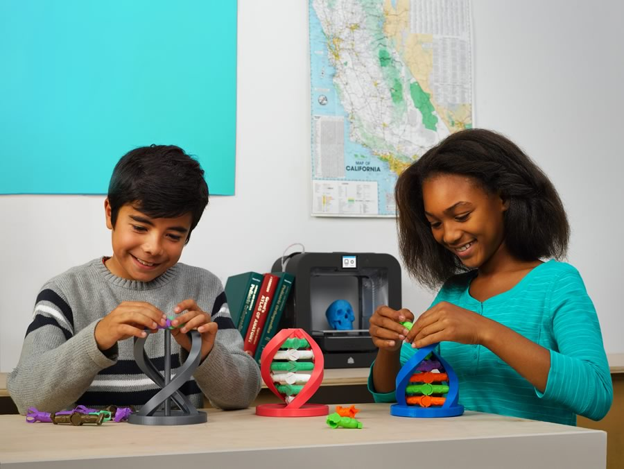 kids playing with 3d printed educational models